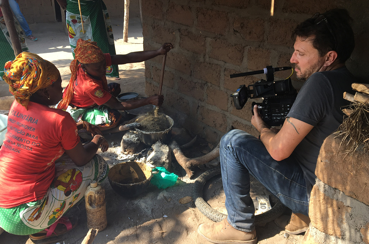 Christoph on location, shooting a group of women cooking in Africa